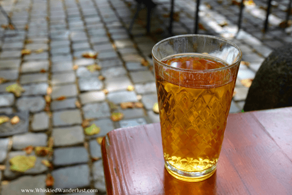 Apfelwein served in a traditional rigged glass in Frankfurt.