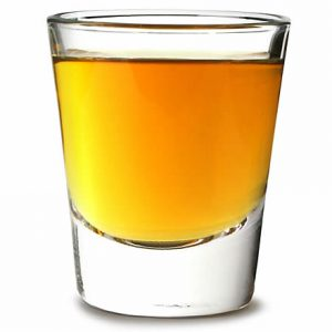 an image of a classic shot glass filled to the brim with whisky