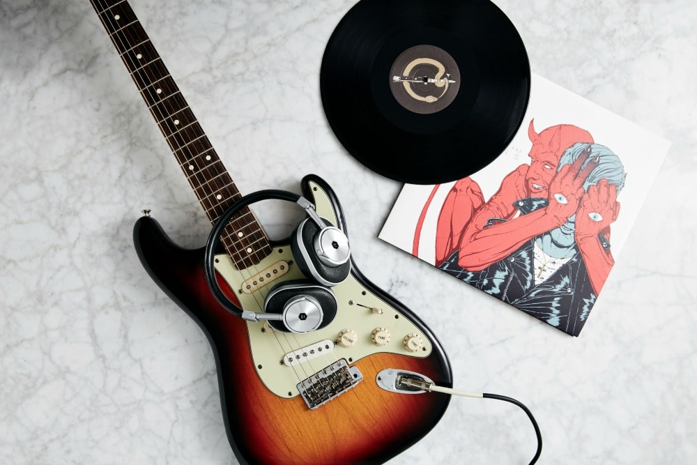 Enjoy Superior Sound Quality with Master & Dynamic Over-the-Ear Wireless Headphones - guitar