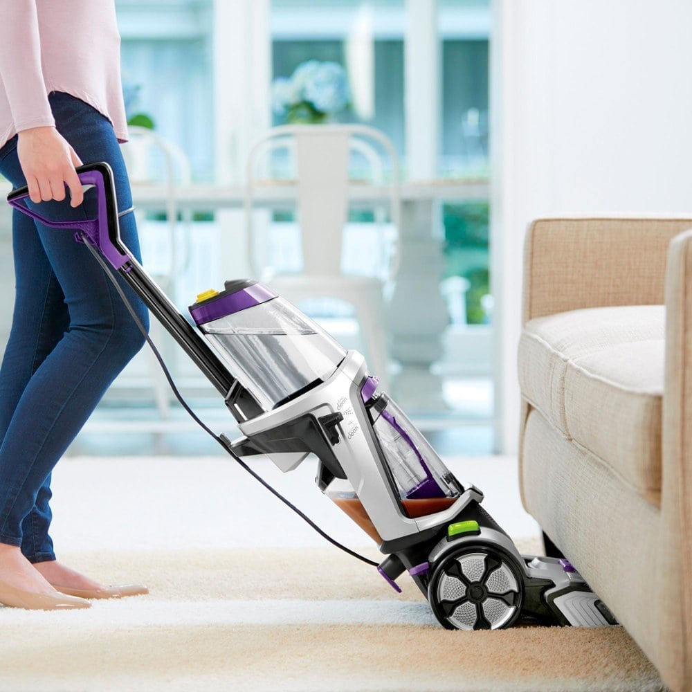 woman Cleaning with BISSELL ProHeat 2X Revolution Pet Pro Upright Deep Cleaner