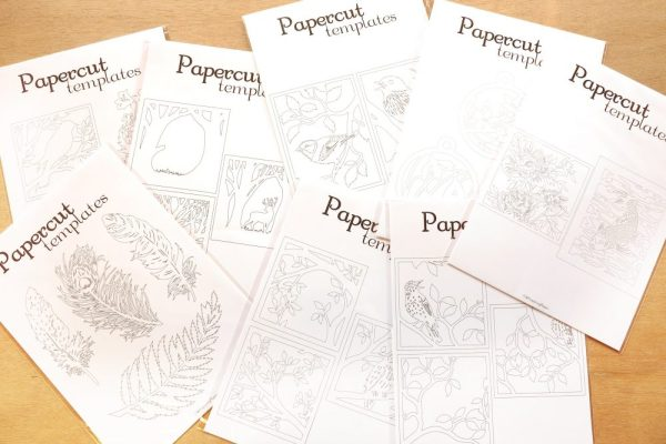 DIY Papercutting template sets on table - Whispering Paper