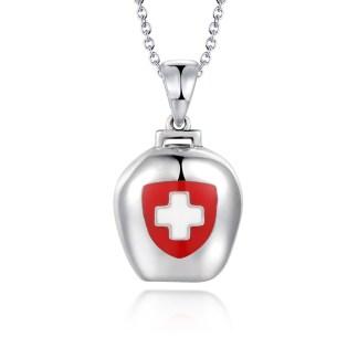 Pendentif en argent 925 en forme de cloche avec une croix suisse et une edelweiss modèle by White Alpina. Oui notre collier cloche by White Alpina sonne ! Un petit tintement viendra adoucir vos journées. Ce magnifique bijou est livré dans un écrin avec une chaîne.