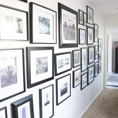 travel gallery- wall gallery- travel photos- how to display- hallway decorating- long hallway- decor- wall decor- black and white photographs- master suite- black framed pictures