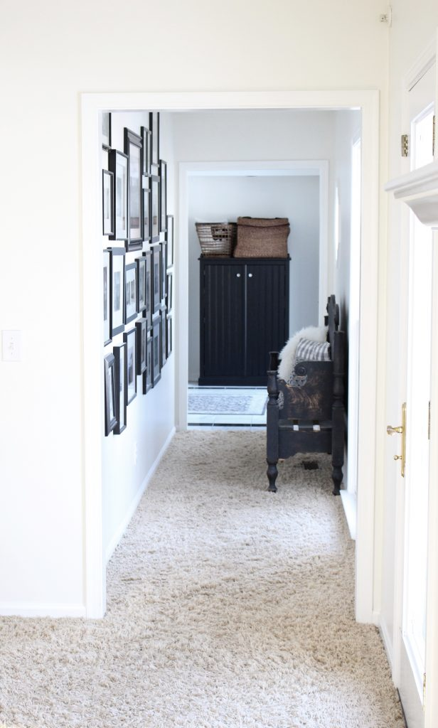 travel gallery- wall gallery- travel photos- how to display- hallway decorating- long hallway- decor- wall decor- black and white photographs- master suite- hallway decor- DIY projects