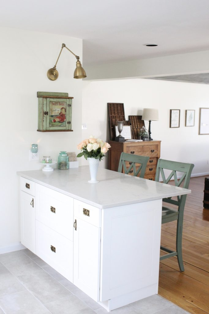 White- Cottage Kitchen- Renovation- Reveal- kitchen design- kitchen decorating ideas- kitchen decor ideas- room design- home decor- design- open shelving- custom island- white cabinets- professional appliances- DIY- Do it Yourself- wood range hood- cottage design- farmhouse kitchen- gray cabinets- peninsula with stools