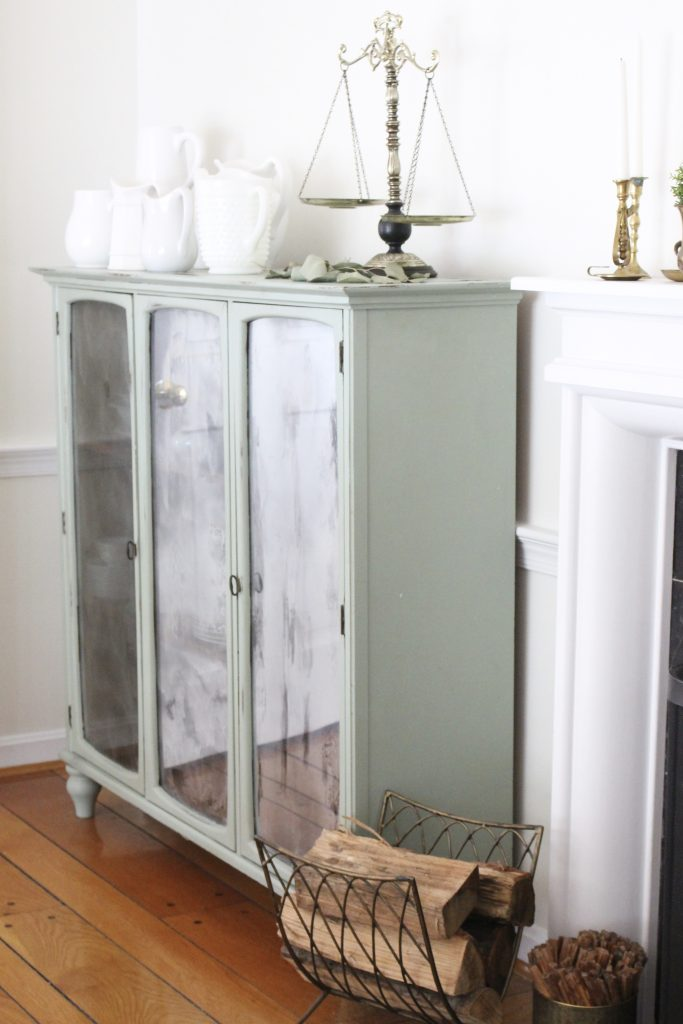 Hutch cabinet makeover- DIY- green- paint- cabinet- Do it Yourself projects- painted furniture- turning a hutch into a cabinet with legs- adding legs to furniture- dining room- furniture- storage piece- mirror spray paint- home decor- room design- green painted furniture