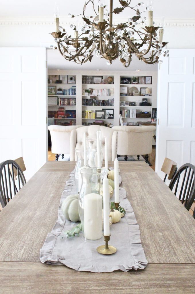 Dining room decked out with cozy cottage fall touches- home design- fall decor- neutral fall- decorating for fall- dining room space- table that seats 10- mix and match dining room chairs- gold and brass accent pieces