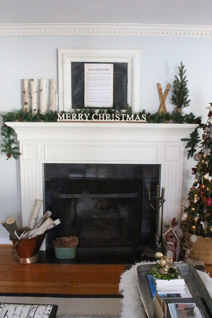 Rustic Christmas Mantel- greenery- birch- animal ornaments- wood- garland- wicker basket- chalkboard- song sheet- mantel- mantles