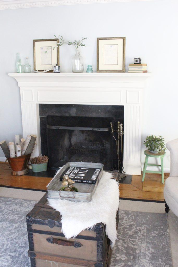 spring mantel-bottles- insulators- vintage cameras- mantel decor- decorating a mantel for spring- mantles- keepsakes- how to use keepsakes in decor- office decor
