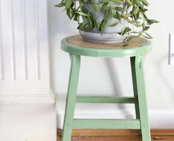 spring mantel-bottles- insulators- vintage cameras- mantel decor- decorating a mantel for spring- mantles- keepsakes- how to use keepsakes in decor- green stool- displaying plants