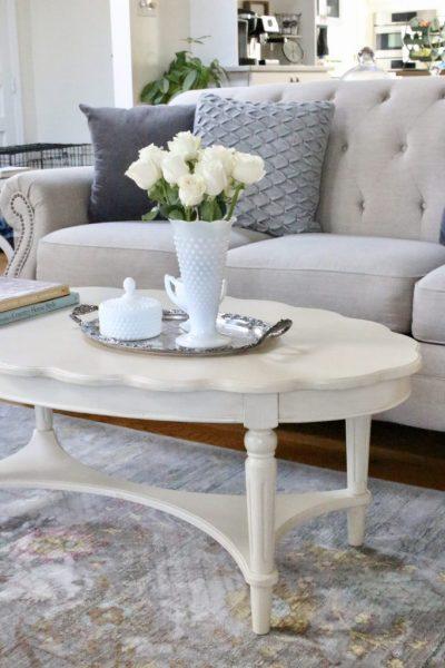 coffee table decor- scalloped edge- French country look- cottage style decor- coffee table styling- spring- pastel- milk glass- vintage items- vintage milk glass vase