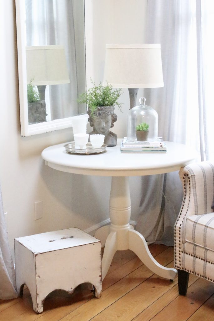 spring- decor- vignette- pedestal table- milk glass- faux greenery- decorating for spring- how to decorate a corner- white decor