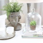 decorating books- spring- decor- vignette- pedestal table- milk glass- faux greenery- decorating for spring- how to decorate a corner- white decor