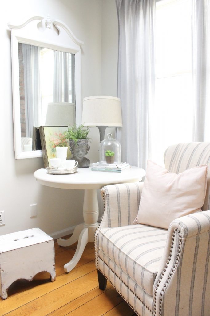 An updated family room space with seasonal spring decor, spring- family room decor- gray washed ceiling- pink decor- gray decor- using pastels in decorating- large family room space- corner vignette