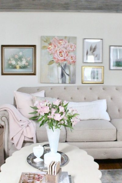 An updated family room space with seasonal spring decor, spring- family room decor- gray washed ceiling- pink decor- gray decor- using pastels in decorating- large family room space- silver collection- milk glass