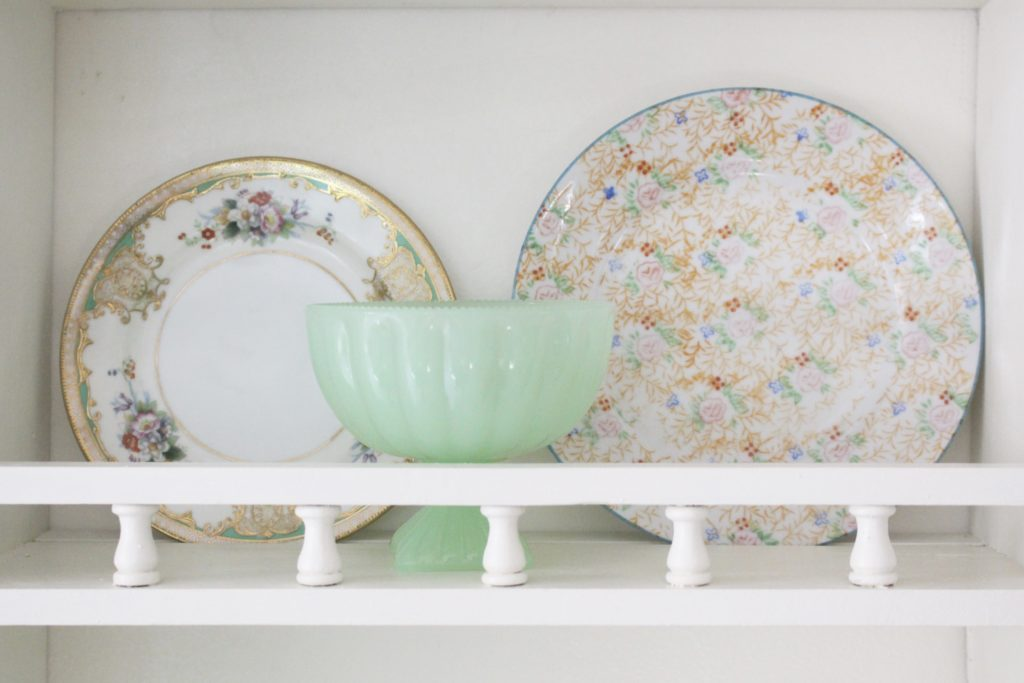 A cute little wood plate shelf- plate rack- wood shelf- jadeite- vintage china- thrifted plates- peninsula- kitchen decor- kitchen decorating- cottage kitchen decor- thrifted dishes
