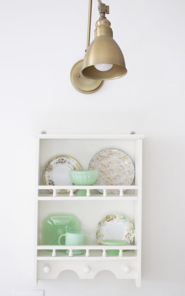 A cute little wood plate shelf- plate rack- wood shelf- jadeite- vintage china- thrifted plates- peninsula- kitchen decor- kitchen decorating- cottage kitchen decor- brass fixture