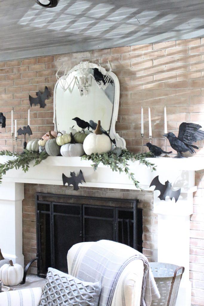 Fall Mantel Updated for Halloween- halloween mantel- crows- bat skeleton- pumpkins- pumpkin patch mantel- cottage style- halloween decor- fireplace decor- decorations for Halloween