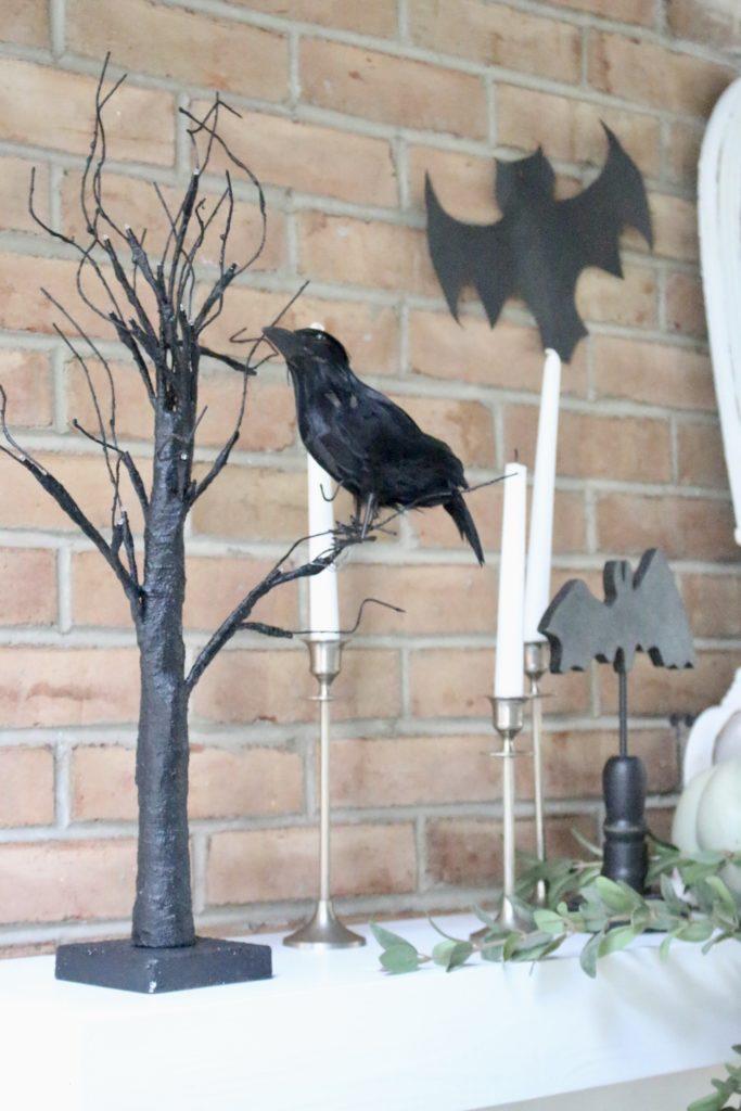 Fall Mantel Updated for Halloween- halloween mantel- crows- bat skeleton- pumpkins- pumpkin patch mantel- cottage style- halloween decor- fireplace decor- decorations for Halloween- farmhouse halloween