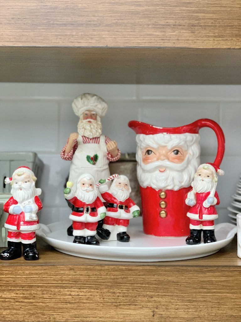 Vintage Santas displayed on our kitchen shelves- display- Santa collection- vintage Santas- Santa mugs- display- open kitchen shelving