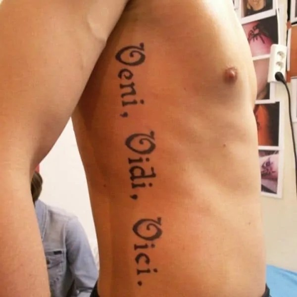 Musciline veni vidi vici on the ribs tattoo