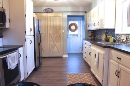 Remodelled Farmhouse Kitchen For cheap, white cupboards, Grey floors