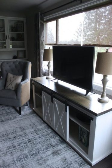 Sliding Barn Door Console with Accent Chair and Wood Lamps