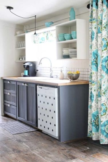 Country Kitchen with Planked wood floor and teal accents