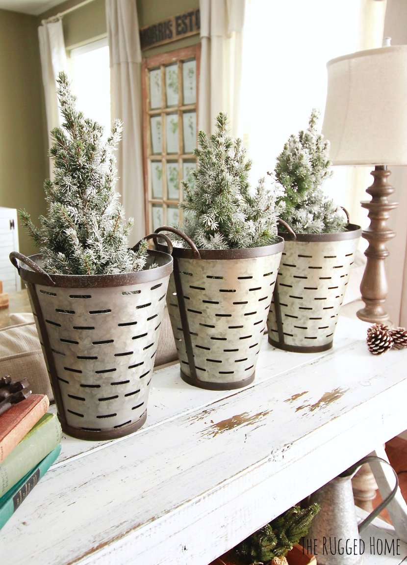 Decorating with Charlie Brown Christmas Trees and Olive Buckets for a total Farmhouse chic Christmas www.whitepicketfarmhouse.com