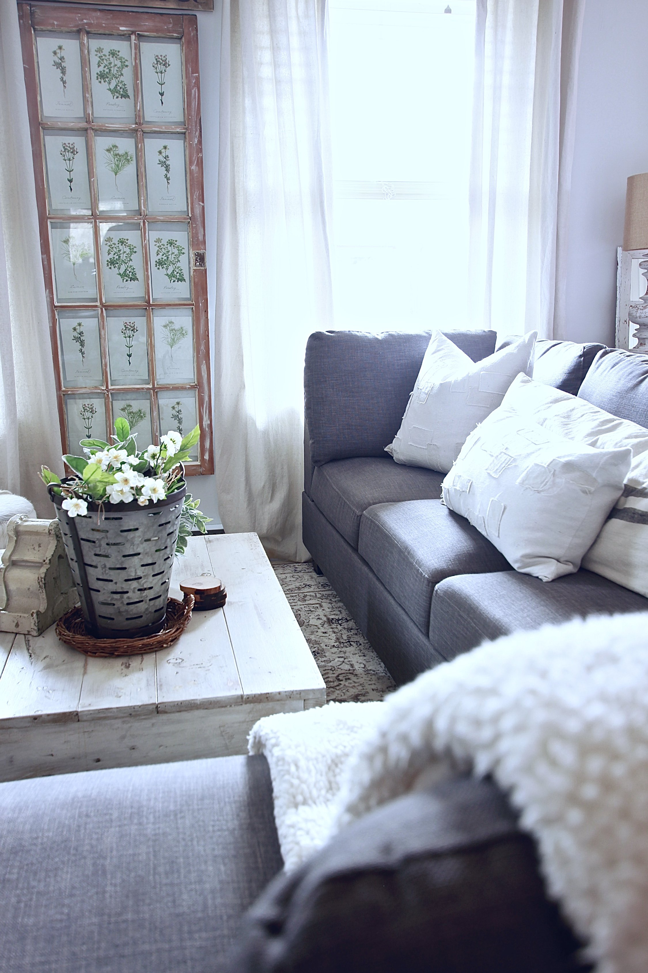 White Woodsy Living Room. Bringing Antique Pieces, Vintage Made Looking Furniture and Decor to create a cozy haven www.whitepicketfarmhouse.com