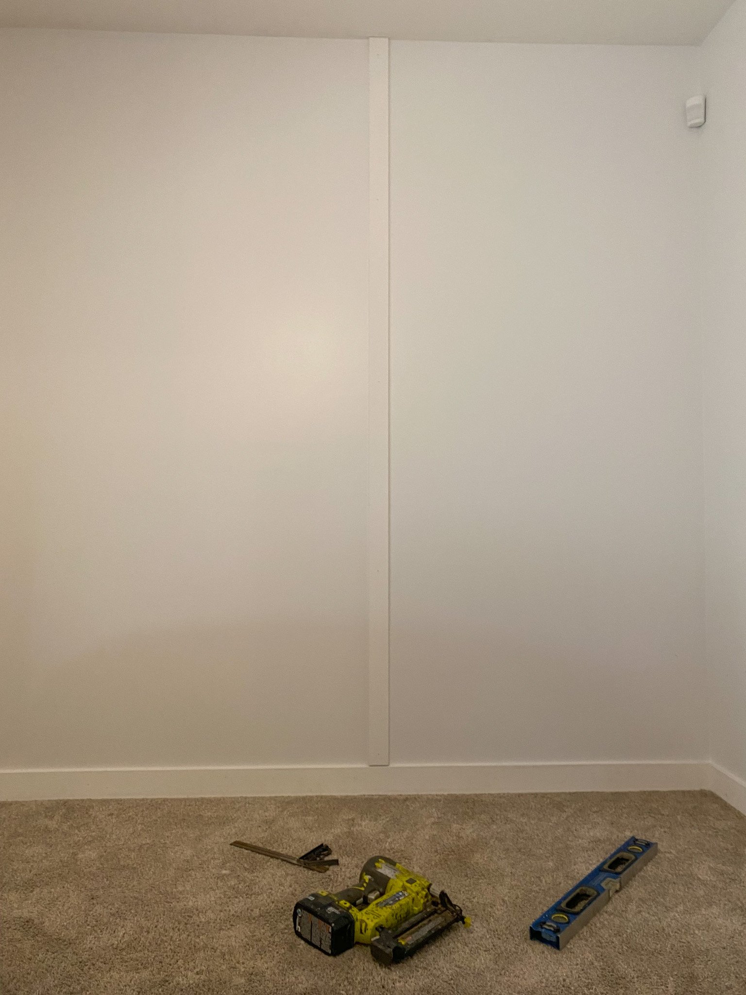 How to build your own Asymmetrical Wood Wall for Under 45.00! Super easy DIY that will make a huge impact in any room. Takes under six hours!