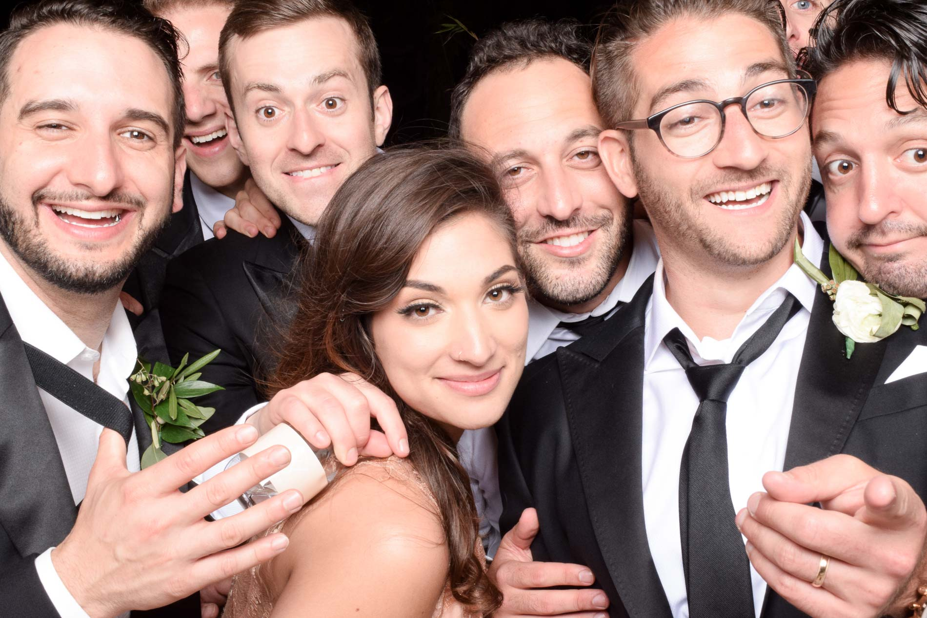 6 guys and a woman take pictures with the groom