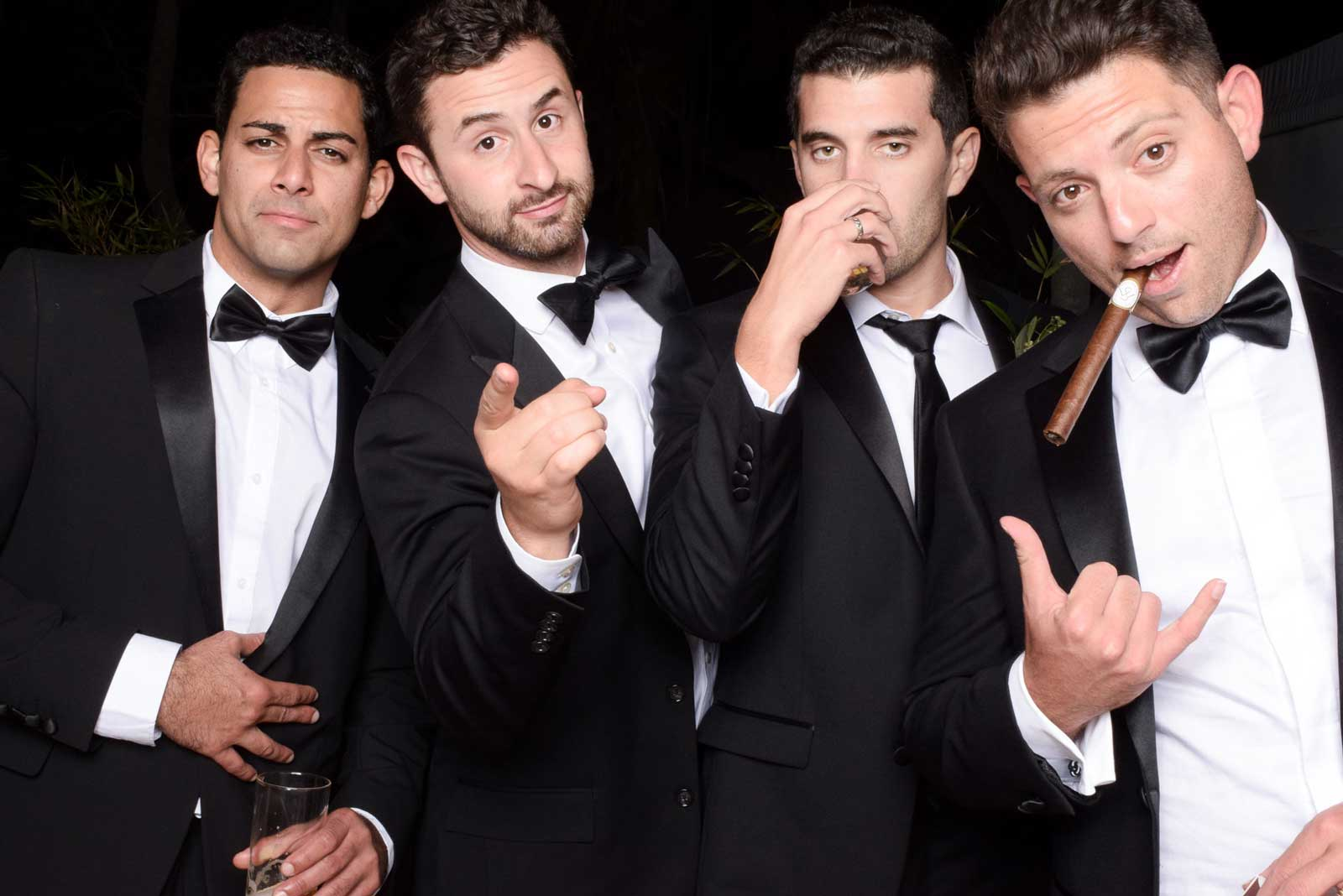 4 guys with Cigars taking a picture with the Photo Booth