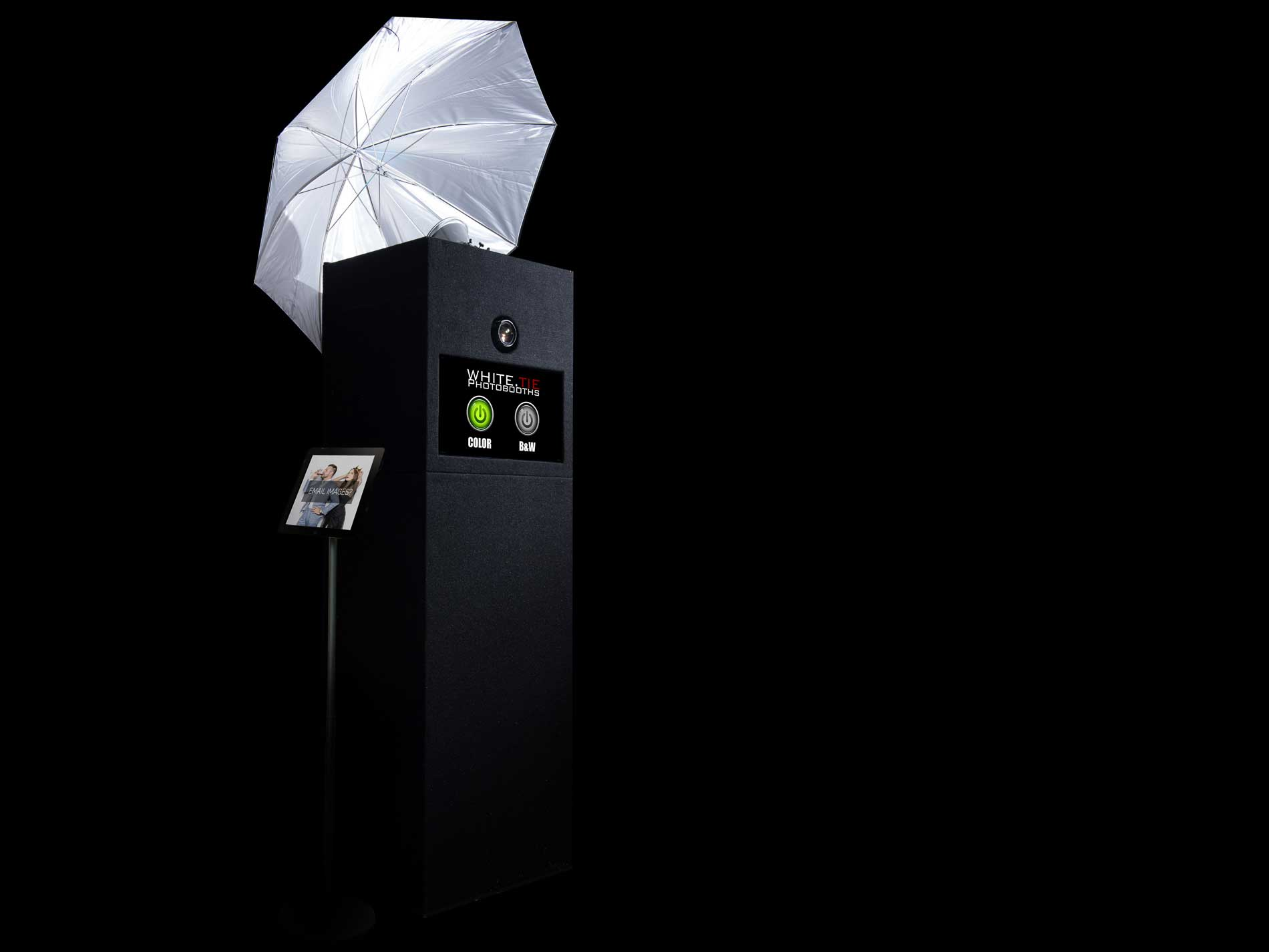 a black photo booth with professional lighting and camera
