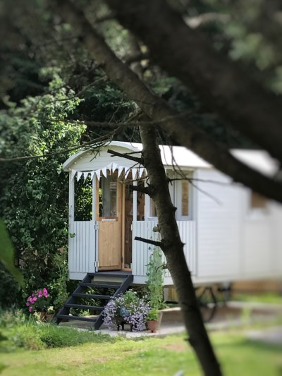 Shepherds Hut through the trees 225x300 - The Shepherds Hut - decorating the inside of beautiful Belle
