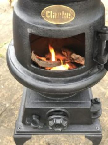 stove being seasoned e1511769871154 225x300 - Pot Bellied Stove - a necessary addition to The Shepherds Hut