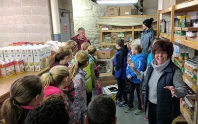 WCS Elementary Students Stock the Food Pantry Shelves