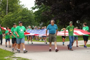 Whitley County 4-H club leaders & members carrying a large United States Flag
