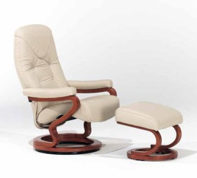 himolla Tamar Recliner shown in cream leather, with footstool, in studio setting.