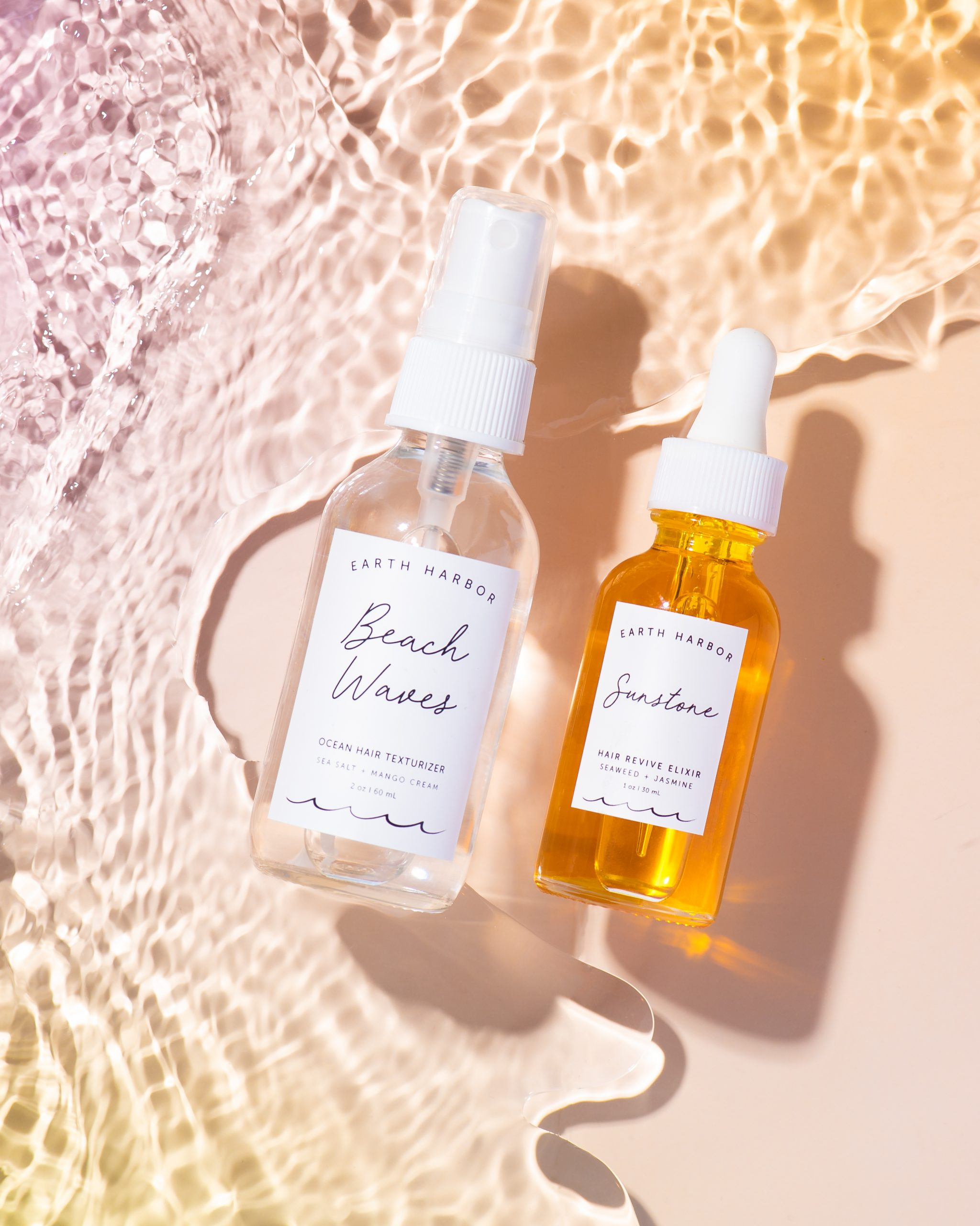 beauty products serums in water with beautiful lighting orange and yellow sunset colorful