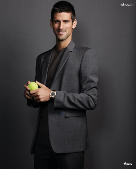 Novak Djokovic In Black Suit With Tennis Ball