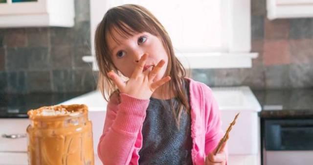 Child Girl Eating Peanut Butter