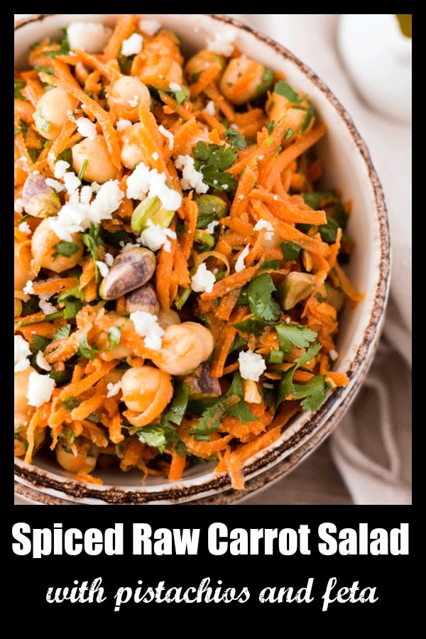 Spiced Raw Carrot Salad with Pistachios is a super-delicious, super-nutritious blend of shredded carrots, basil, parsley mint, chickpeas, pistachios and feta cheese. It comes together in just 15 minutes, and makes a great side for dinner when paired with some grilled chicken or a great on-the-go lunch as is.