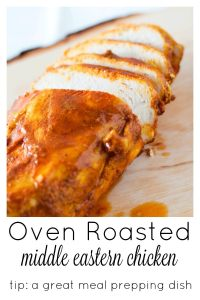Oven Roasted Middle Eastern Chicken Breasts sliced on a wooden chopping board