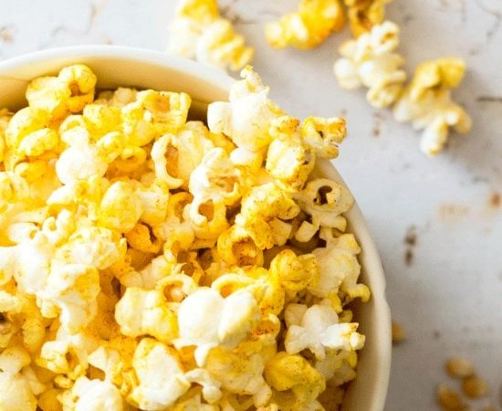 making popcorn on the stove: a bowl of popcorn