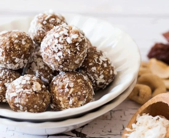 Easy No Bake Cashew Coconut Date Balls in a white bowl