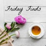 Friday Finds written on a white wooden board with tea and flowers