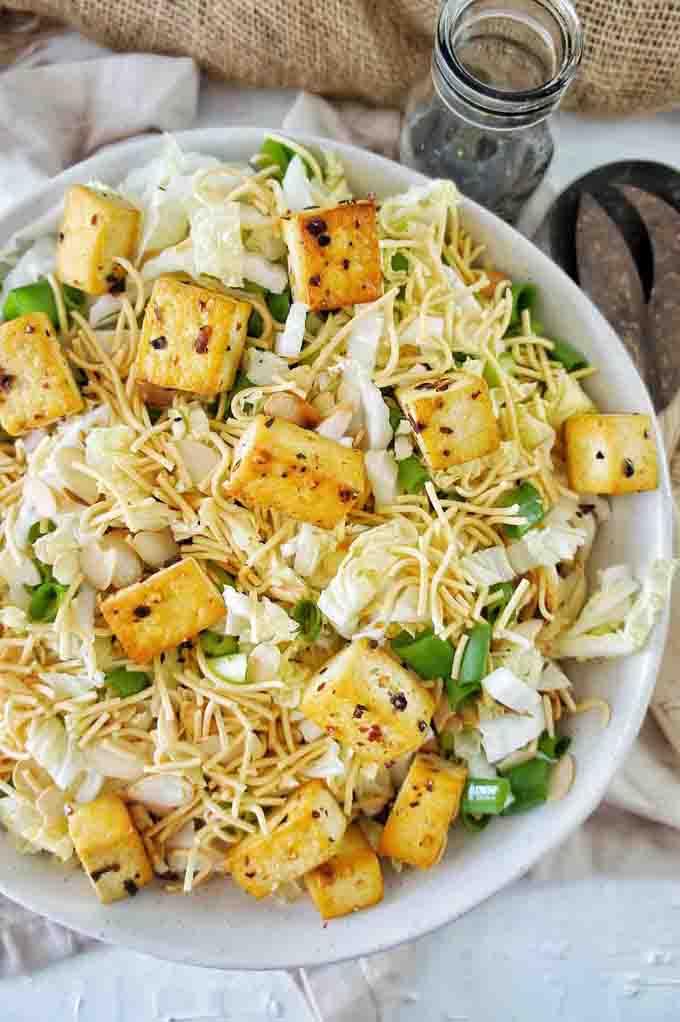 assembled Crispy tofu noodle cabbage salad in white bowl