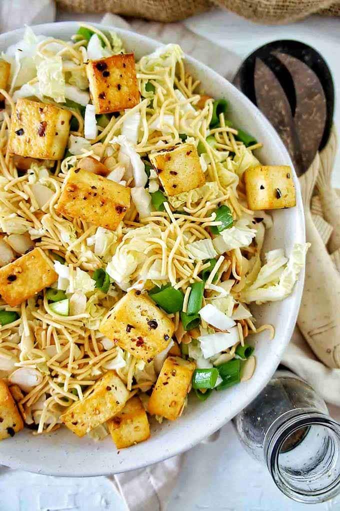 Up close shot of Crispy Tofu Noodle Salad in a white bowl