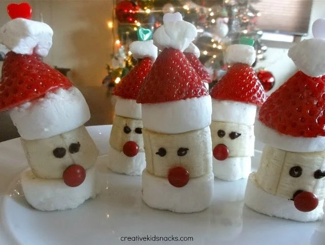 santa party poppers made with banana strawberry and marshmallows